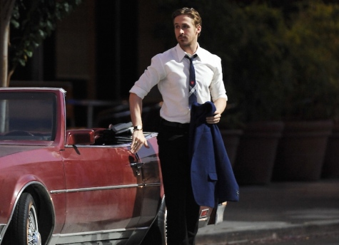 "Acotr Ryan Gosling puts on a serious face while getting last minute instructions on the set of ""La La Land"" filming in Pasadena while co star Emma Stone goofs around with the film crew. Featuring: Ryan Gosling Where: Pasadena, California, United States When: 18 Aug 2015 Credit: Cousart/JFXimages/WENN.com"